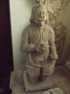 Kneeling figure (left)