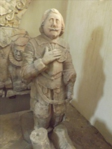Kneeling figure (right)